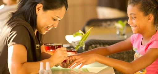 Tween girl getting manicure