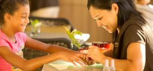 Tween girl getting manicure
