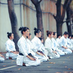 Asians meditating