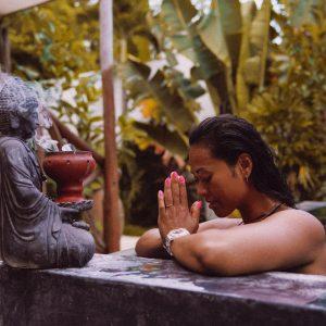 Praying to Buddha statue